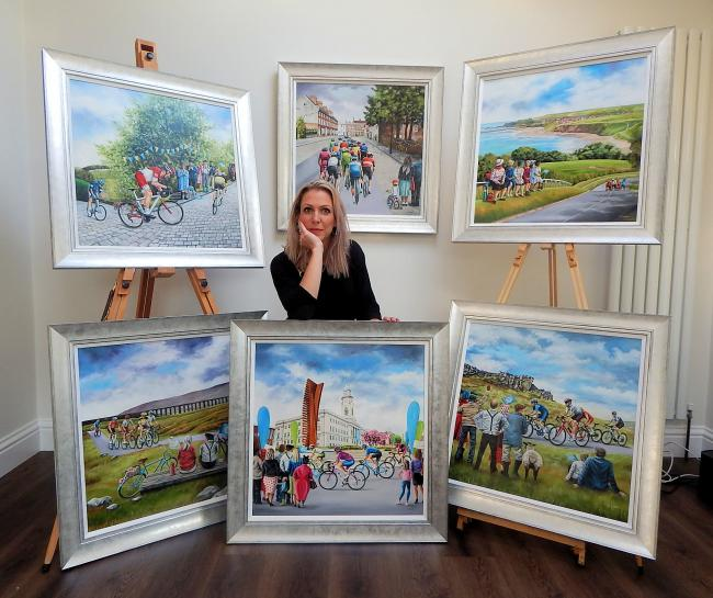 Claire Baxter with her paintings