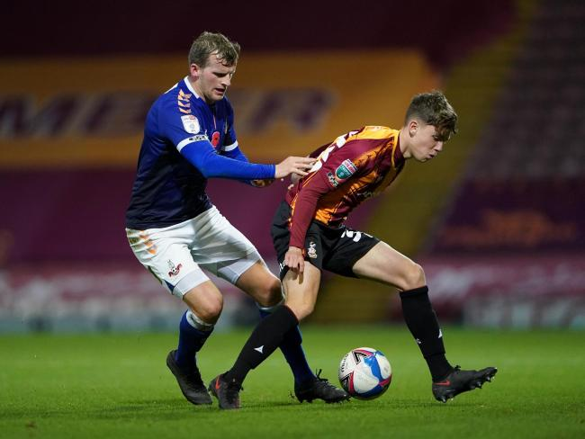Charlie Wood, battling it out for the first team against a familiar face in then-Oldham striker Danny Rowe, opened the scoring for City's U18s against Mansfield. Picture: PA.