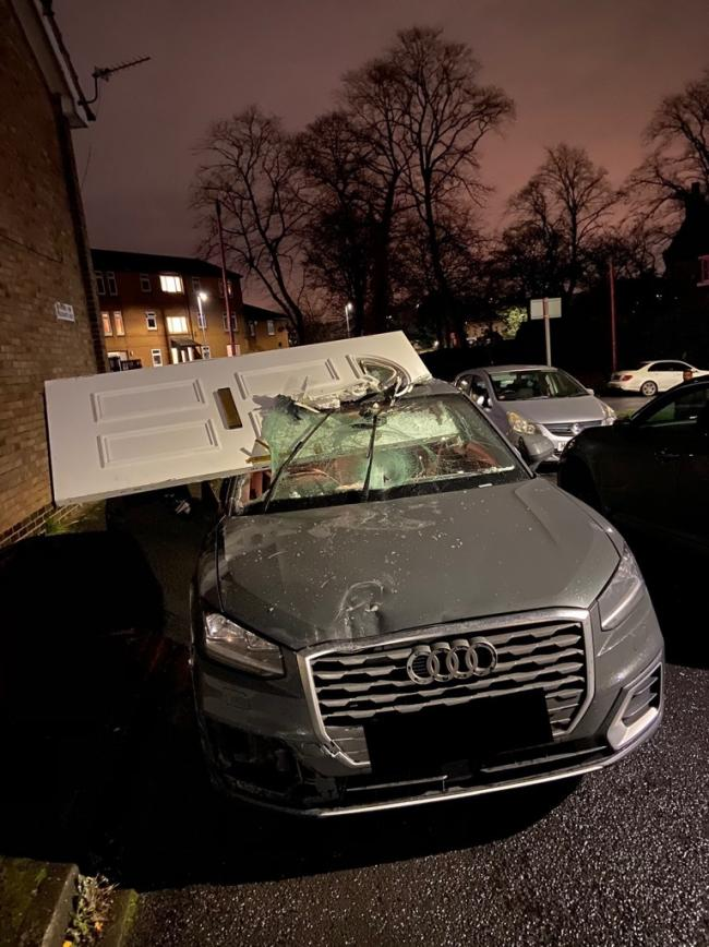 This Audi had a front porch door lodged in the top of it after a crash, but the driver still carried on going.