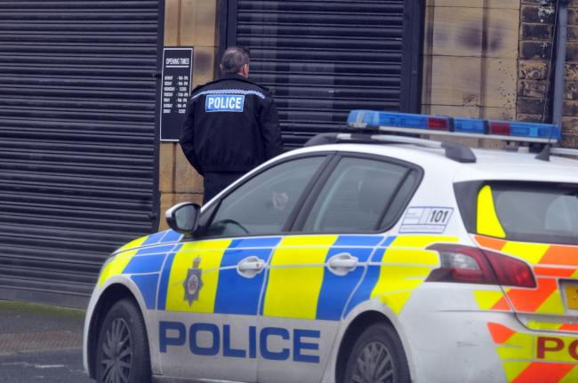 Police outside the salon today.