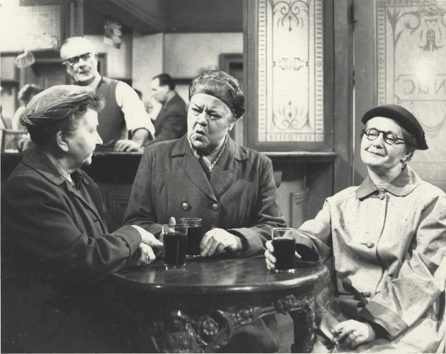 Ena Sharples (Violet Carson, centre) holds court in the Rover's Return