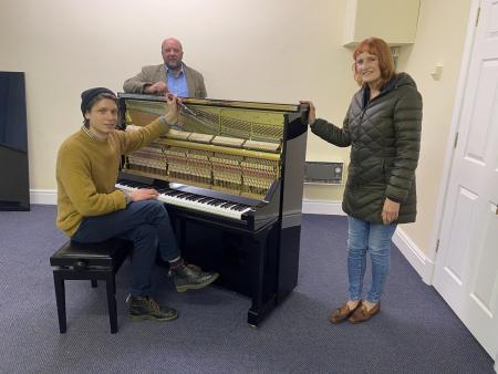 Mike Derrett, left, piano tuner with Yorkshire Pianos. Adam Cox Yorkshire Pianos owner and host Irene Truman