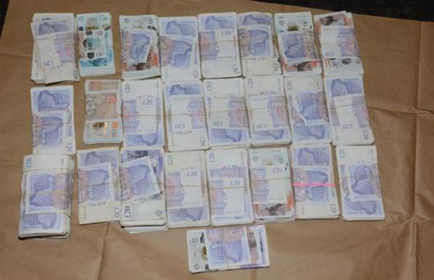 Bradford Telegraph and Argus: Cash seized during the police investigation