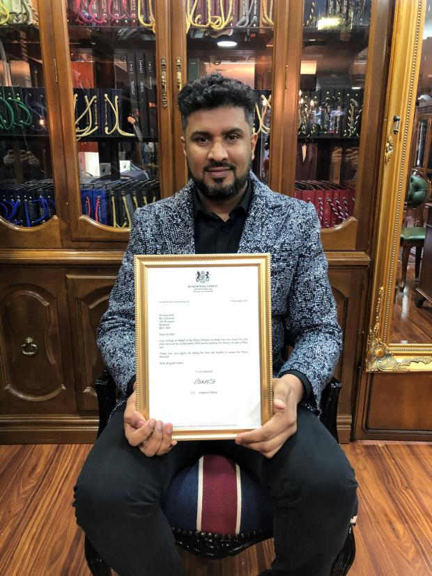 Bradford Telegraph and Argus: Imran Khan, of IK Collections, with his letter from 10 Downing Street