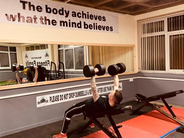 Bradford Telegraph and Argus: Jordan Lilley works out in his new gym
