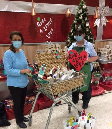 Cancer Support Yorkshire charity fundraiser Linda Enderby collects the prizes from the Otley Waitrose store