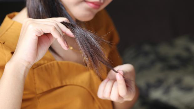Bradford Telegraph and Argus: Sleeping on wet hair can lead to breakage and split ends. Credit: Getty Images / Monthira Yodtiwong