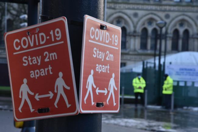 Covid signs in Bradford's Centenary Square