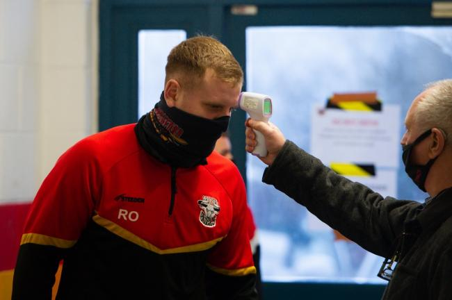 Ross Oakes has his temperature checked before the Bulls' first training session. Picture: Tom Pearson