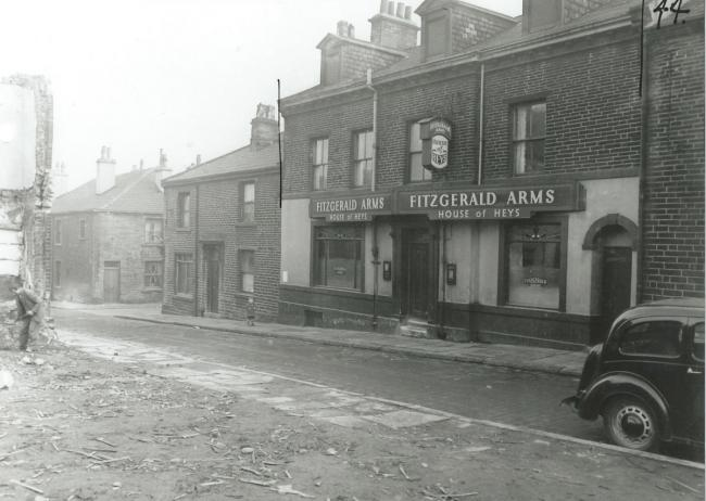 The Fitzgerald Arms off Manchester Road. Who is the boy looking at the photographer?