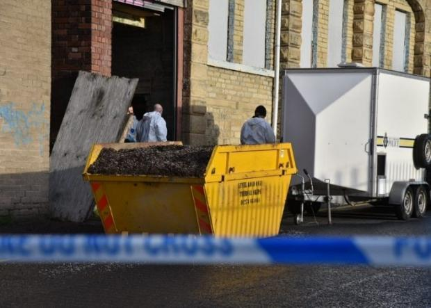 Bradford Telegraph and Argus: Forensic officers at the scene of the Filey Street cannabis farm bust