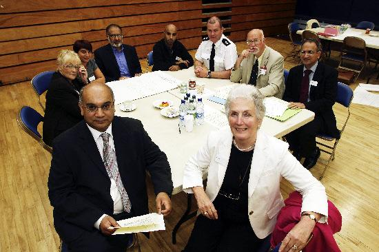 Bradford Telegraph and Argus: Joining Keighley MP Ann Cryer and Home Affairs Select Committee chairman Keith Vaz MP are, back, from left, Cllr Doreen Lee, Keighley East; Tracey Smith of the Whinfield Centre; Ghulam Rabani, Sangat Centre; Amjad Zaman, Greenhead High School; Insp Mark A
