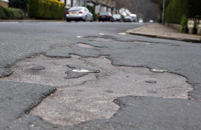 Anger at cut in funding for roads maintenance