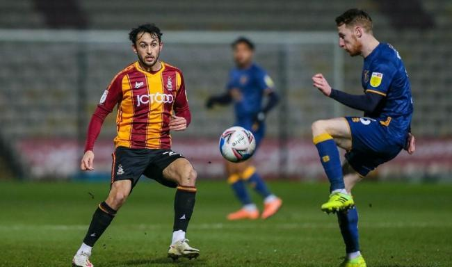 Bradford City's Levi Sutton, left, in action against Mansfield Town during his side's 1-0 win at Valley Parade last night. Picture: Thomas Gadd