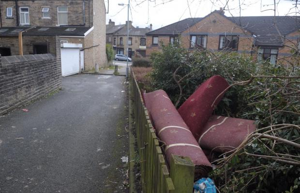 Bradford Telegraph and Argus: Red carpets among items dumped on streets in Barkerend. More examples of fly-tipping in the ward below
