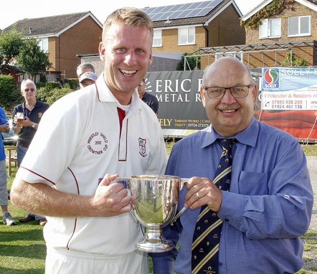Woodlands skipper Steven Pearson receiving the Crowther Cup from then-Heavy Woollen Cup president Philip Radcliffe in 2013. Picture: Bradford League