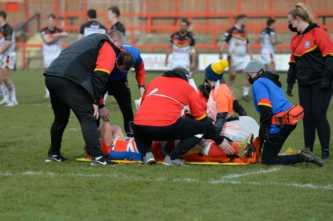 Alix Stephenson is treated on the pitch after his dreadful injury on Saturday. Picture: Tom Pearson.