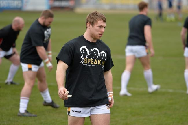 Sam Hallas warms up before the Challenge Cup tie against Featherstone. Picture: Tom Pearson.