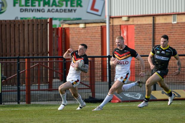 Bradford Telegraph and Argus: Brandon Pickersgill races down the sideline for a spectacular long-range try