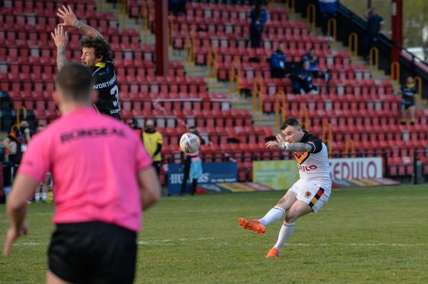 Bradford Telegraph and Argus: Jordan Lilley's match-winning drop goal is up and on its way