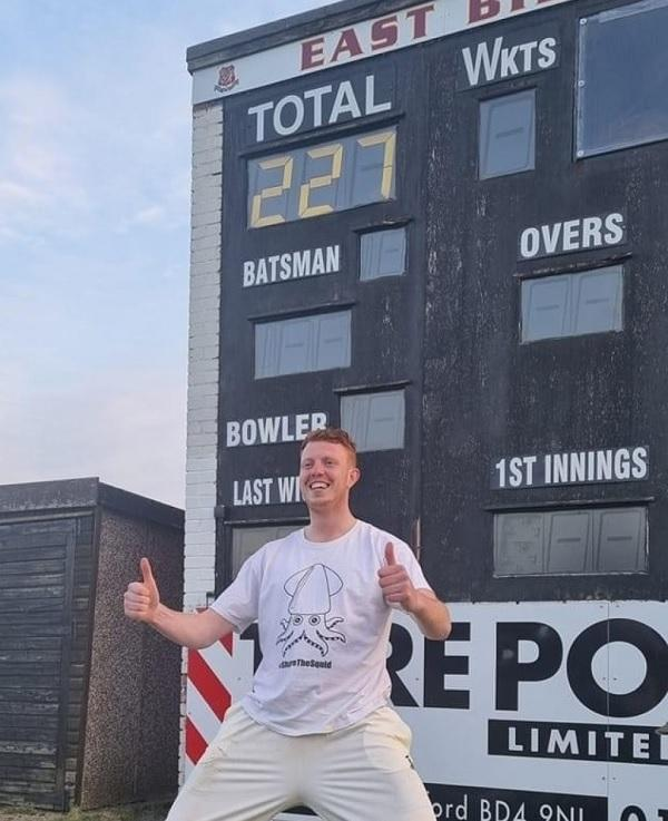 Ben Walter celebrates in front of the scoreboard after his astonishing knock of 227 not out saw East Bierley home.