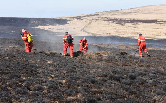 Firefighters continue to battle a fire on Marsden Moor this afternoon. Picture: West Yorkshire Fire and Rescue Service