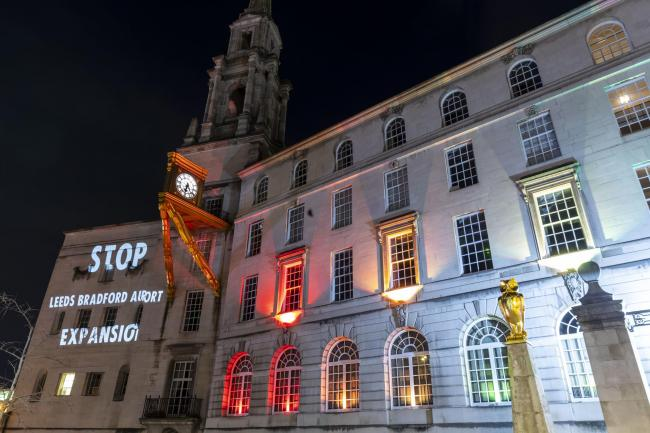 A projection on Leeds Civic Hall calling for a stop to the airport expansion
