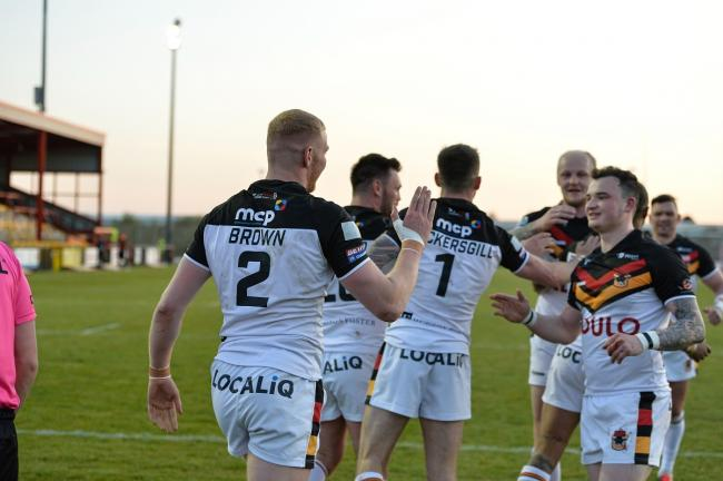 Joe Brown is congratulated by his team-mates after scoring against Dewsbury. Picture: Tom Pearson.