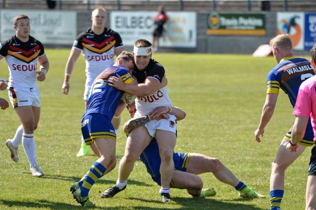 Ebon Scurr makes more inroads into the Whitehaven defence during Sunday's win. Picture: Tom Pearson