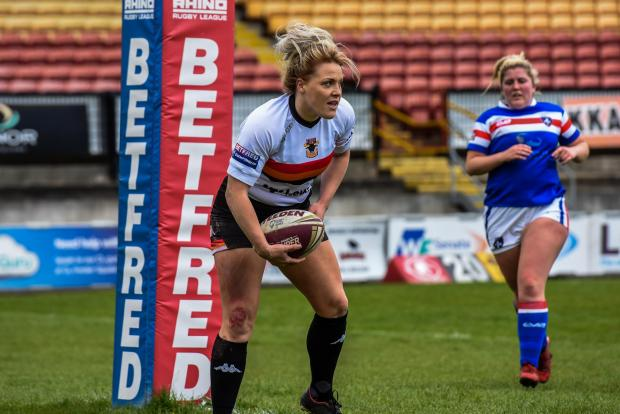 Bradford Telegraph and Argus: Amy Hardcastle in action for Bradford Bulls. Picture: Tom Pearson