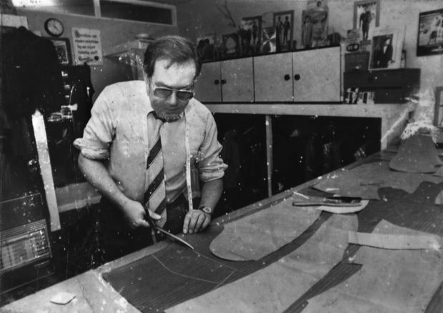 Bradford Telegraph and Argus: Ray Lister working as a tailor before he initially retired