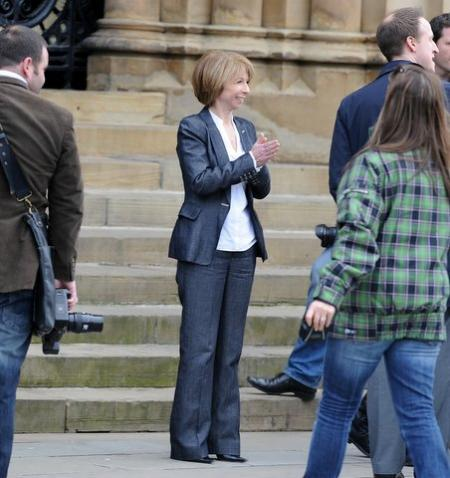 Gail McIntyre (Helen Worth) takes a break from filming outside City Hall.