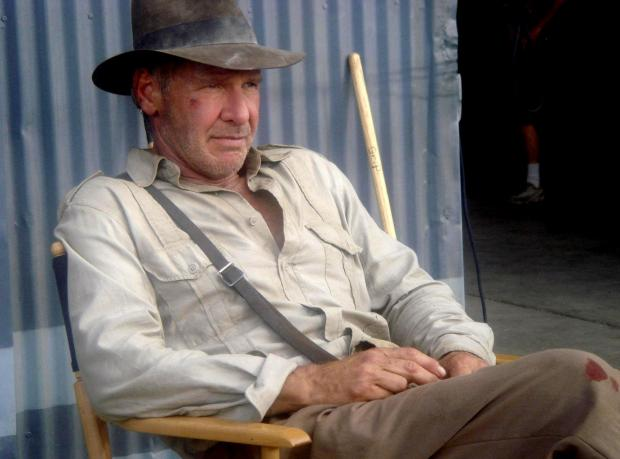 """Bradford Telegraph and Argus: THE MAN WITH THE HAT IS BACK: For the first time since 1989, Harrison Ford dons the familiar costume on Thursday, June 21, 2007, as the upcoming """"Indiana Jones"""" adventure begins production under the direction of Steven Spielberg. The new"""