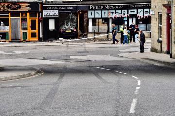 Seriously injured man arrested over Pudsey barber shop crash