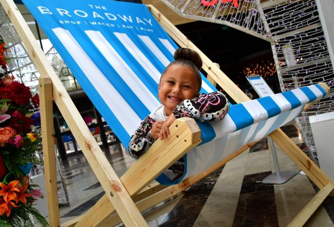 Inaaya Dass tests out the giant deckchair in The Broadway
