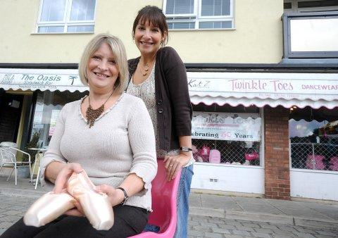 Twinkle Toes owner Ann Hassan (front) with her daughter, Michelle, outside the shop in Barkerend Road, which is marking its 50th year