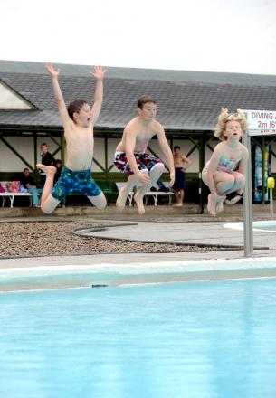 Youngsters enjoying Ilkley Lido on a sunny day