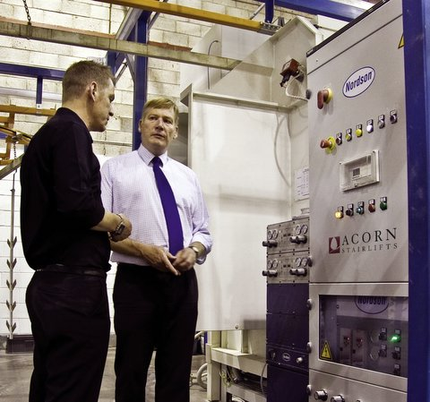 Acorn Stairlifts factory manager Andrew Longthorne with MP Kris Hopkins during his visit