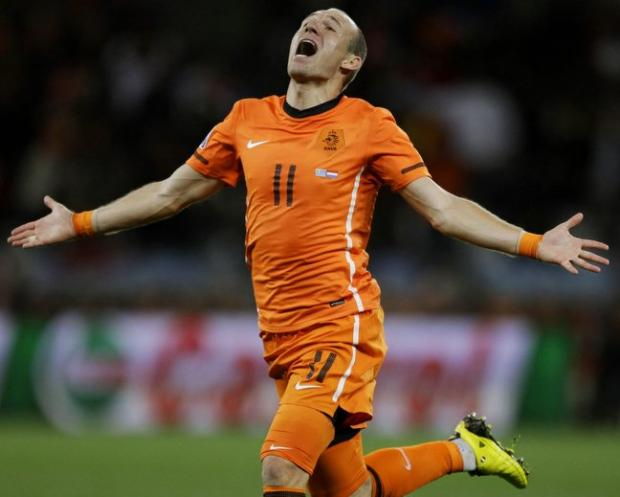 Arjen Robben celebrates scoring against Uruguay in the semi-final