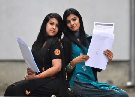 A-level students Iram Hussain and Ummera Ahmed with their results at Challenge College.