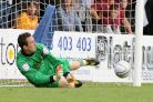 Jon McLaughlin saves from the penalty spot against Torquay