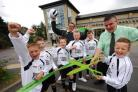 Mark Robinson helps players from Horton Foxes open the new-look Co-op store in Clayton