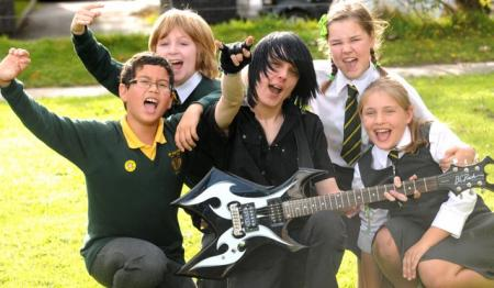 Pupils at St Joseph's Catholic Primary School, Otley, take part in a rock school. Pictured are Shaun Street, Joel Cacciola, guitarist Steven Brodowski, Emily Broswell and Freya Gustafson.