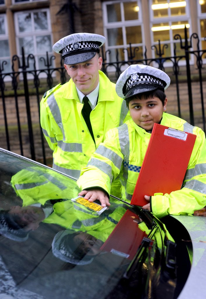 Pictured on patrol at Green Lane Primary school are Sgt Barron and Shahbaz Khalid, ten
