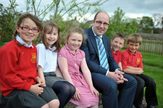 From left, St Francis pupils Mariela Wright, Honor Sutcliffe, Edie O'Neil-Tolley, head teacher Daniel Copley, Darwin King and James Hebb
