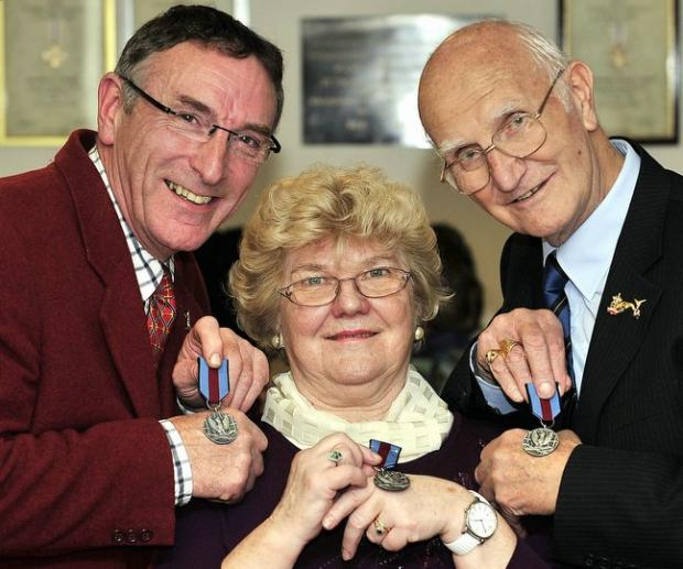From the left, Peter Whitaker, Romana Pizon and Jim Hartley with Pro Memoria medals from the Polish Consul