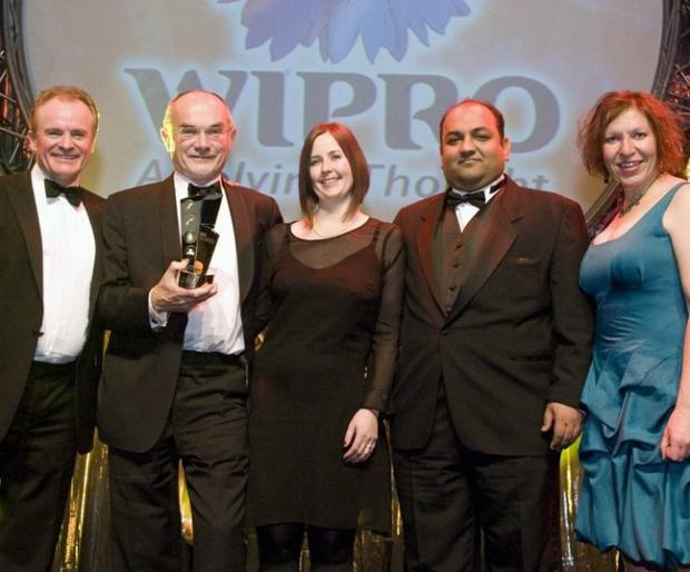 Pictured are Alan Harrison, Loop director (second left) and  Zoe Mason head of customer service (centre) with the Utility Week customer care award