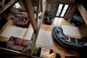 The living room with its exposed beams and stone walls