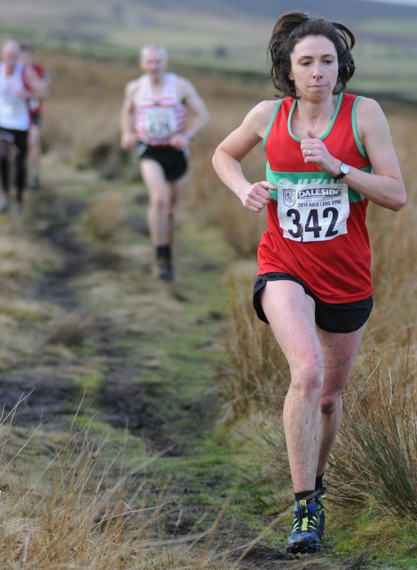 Ilkley Harriers' Sally Morley on her way to fifth place in the Auld Lang Syne Fell Race. Credit: Dave Woodhead