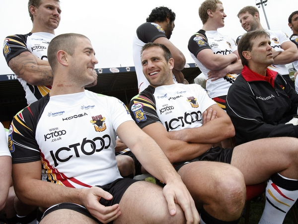 Andy Lynch and Matt Diskin share a joke before posing for the Bulls' 2011 team photo